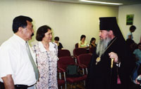 The Kalmyk minister of culture N. Sanjiev, IBT translator V. Shugraeva, Archbishop Zosima.